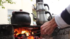 Fireplace in garden with teapot. Fireplace in garden with Turkish teapot stock video footage