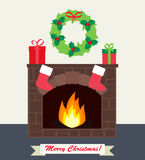 Fireplace with gifts  and Christmas stockings. Fireplace with gifts, Christmas wreath and Christmas stockings Royalty Free Stock Photo
