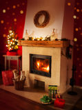 Fireplace with gifts, christmas tree - home interior decoration Stock Images