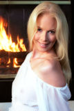 Fireplace Girl. Attractive girl next to a fireplace Royalty Free Stock Photo