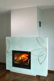 Fireplace with Glass Surround. Fireplace shown with a floral design glass surround Stock Photos