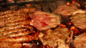 Fireplace with grilled meat during cooking on the grill stock video footage