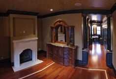 Fireplace and hallway. Stone fireplace in a hallway area Royalty Free Stock Photo