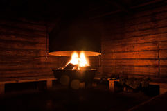 Fireplace inside the forest hut Royalty Free Stock Images