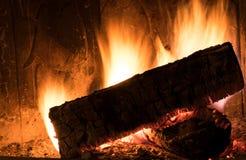 Fireplace inside home burning wood Royalty Free Stock Photo