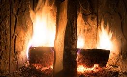 Fireplace inside home burning wood Stock Photo