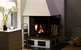 Fireplace inside home burning wood. For heating and recreational use, or simply romantic snuggle time Stock Photography