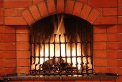 Fireplace with iron lattice Royalty Free Stock Photo