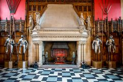 A fireplace and knight armor inside of Great Hall in Edinburgh Castle. Scotland royalty free stock images