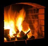 Fireplace. Logs burning inside a fireplace royalty free stock photo
