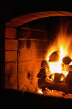 Fireplace. Logs burning inside a fireplace Royalty Free Stock Images
