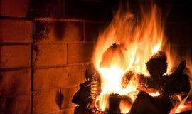 Fireplace. Logs burning inside a fireplace stock image