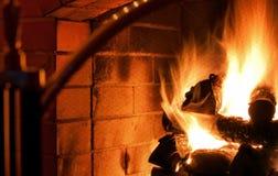 Fireplace. Logs burning inside a fireplace stock photos