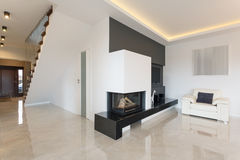 Fireplace in luxury detached house Royalty Free Stock Photography