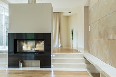 Fireplace in luxury mansion Royalty Free Stock Photos
