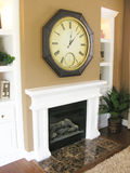 Fireplace and Mantle. A photo of a contemporary fireplace, mantle, and clock Stock Photography