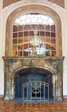 Fireplace and mirror in House of Scientists, Lviv, Ukraine royalty free stock image