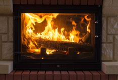 Fireplace. At modern home with set fire stock photo