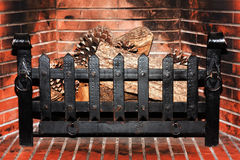 FirePlace with no fire. Used Fireplace ready with some trunks and pines Royalty Free Stock Images