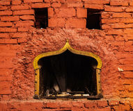 Fireplace. Old fireplace with brick wall sourounded Stock Photography
