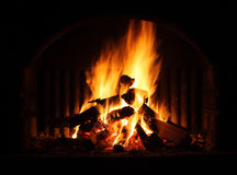 Fireplace. Outdoor Fireplace with a fire at night royalty free stock image