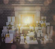 Fireplace with presents on wooden floor. Stock Images