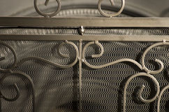 Fireplace with protecting metal screen. Royalty Free Stock Images