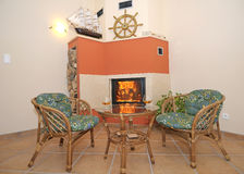 Fireplace and rattan chairs Stock Photo