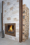 Fireplace with raw iron I profiles and wood Royalty Free Stock Photos
