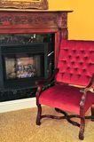 Fireplace and red chair Royalty Free Stock Images