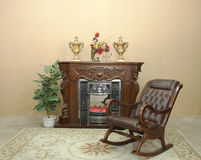 Fireplace and rocking chair Royalty Free Stock Images