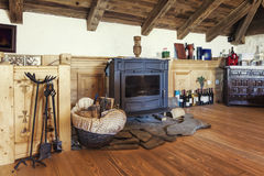 Fireplace in a rustic attic room Stock Photography