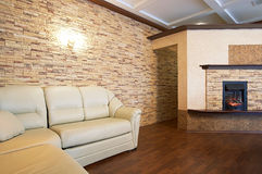 Fireplace and sofa stock image