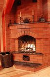 Fireplace with some fire tools. In country house royalty free stock photos