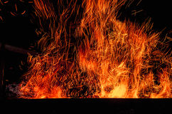 Fireplace with sparks in dark. Background Royalty Free Stock Photography