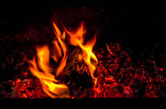 Fireplace with sparks in dark. Sparks and coals of fire in dark background Stock Image