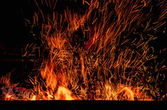 Fireplace with sparks in dark. Many sparks of fire in dark background Royalty Free Stock Image