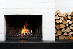 Fireplace and stacked wood Stock Image