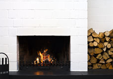 Fireplace and stacked wood Royalty Free Stock Photos