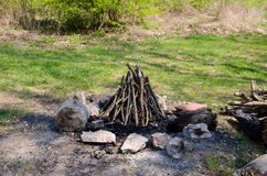Fireplace of stone on green grass. For baking bacon and sausages Royalty Free Stock Photos