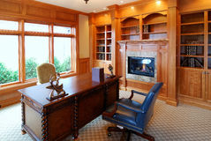 Fireplace in a study. Luxury Study with a fireplace Royalty Free Stock Photo