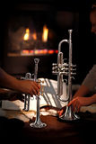 Fireplace, trumpet, music Royalty Free Stock Photography