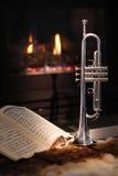 Fireplace, trumpet, music Royalty Free Stock Image