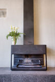 Fireplace with vase with lily Royalty Free Stock Photo