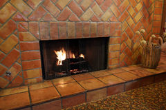Fireplace and wall tiles and bricks Royalty Free Stock Photo