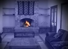 Fireplace of a warm house. All blue except the fire Royalty Free Stock Images