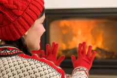 Fireplace warming up happy woman winter home Royalty Free Stock Photo