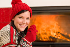 Fireplace warming up happy woman winter home Royalty Free Stock Photos