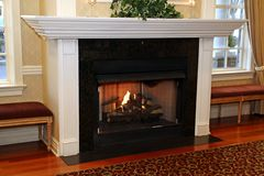 The fireplace with the white wood trim makes this room loo k great. stock image