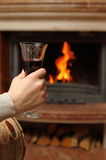 Fireplace and wine Royalty Free Stock Images
